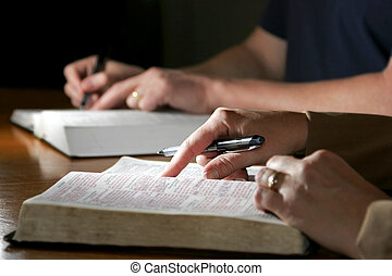 Bible Study Couple - A man and woman or married couple study...