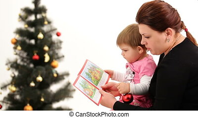 Christmas story - Mother reading a Christmas story to her...