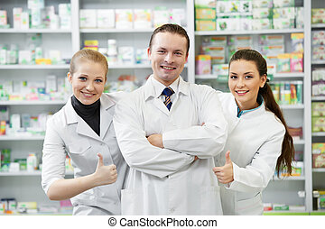 Pharmacy chemist group in drugstore - Team of cheerful...