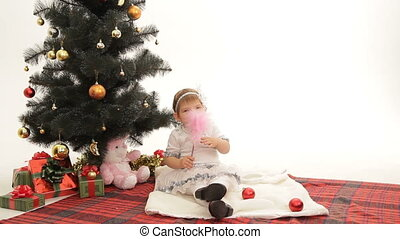 Christmas Eve - Child waiting for Christmas under a...