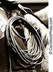 Authentic Cowboy Riding sepia - Closeup of an authentic...