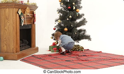 Christmas present - Little girl finding her presents under...