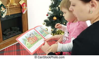 Christmas tale - Mother reading a Christmas tale to her...