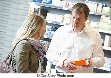 pharmacy chemist workers in drugstore