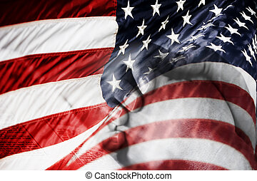 American Flag with Praying Hands - A blended image of an...