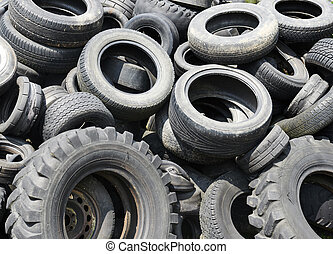 Used car tyres garbage for recycling - Heap of black old...