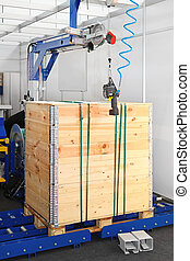 Packing crate - Wood crate secure packing at conveyor...
