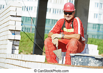construction mason worker bricklayer - Portrait of Builder...