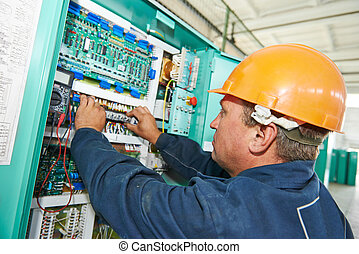 electrician working at power line box - electrician at work...