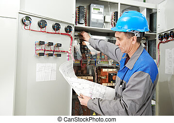Electrician working at power line box - One electrician...
