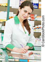 Pharmacy chemist woman in drugstore - pharmacist chemist...