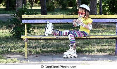 little girl with roller skates