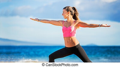 woman practicing yoga - Young woman practicing yoga on the...