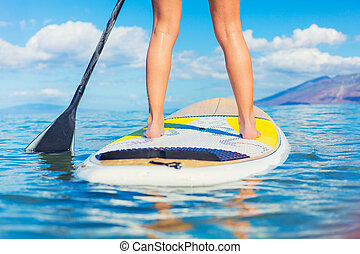 Stand Up Paddle Surfing In Hawaii - Attractive Young Woman...