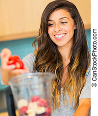Woman Making Fresh Fruit Smoothie