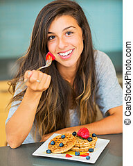 Woman Eating Breakfast - Woman Eating Waffles with Fresh...