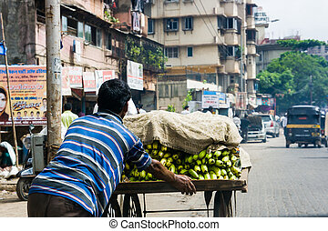 Banana Seller i n Mumbai - A banana seller pushes his cart...