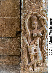 carving detail of a women in krishna temple, Hampi,...