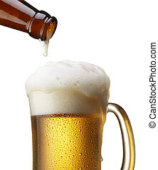pouring beer - beer in bottle pouring into mug, isolated