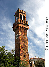 historic high Bell Tower with clock in the island of Murano...