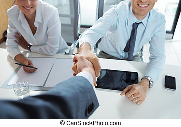 Welcome to the team - Businessman being welcomed into the...