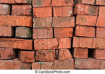 stack of red clay bricks
