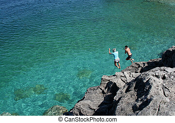 Cliff Jumping - Two girls jumping off the cliffs at Cypress...