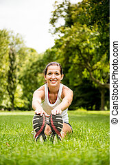 Stretching exercise - sport woman outdoor