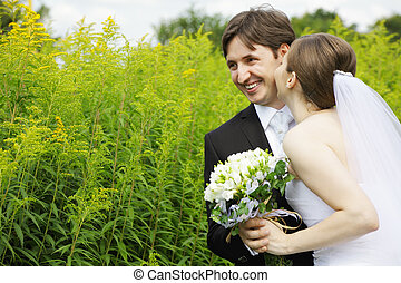 Happy couple with flowers outdoors