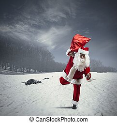 Running Santa Claus with sack of gifts
