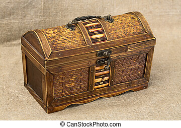 Chest - Wooden chest with iron handles on the sacking...