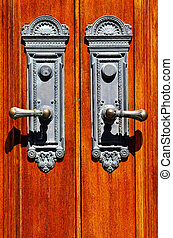 Old Wooden Door Handles - Old iron door handles on worn...