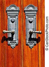 Old Wooden Door Handles - Old iron door handles on worn...