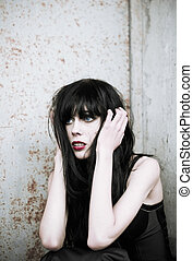 Portrait of shocked and scared goth girl - Portrait of a...
