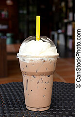 Take-home cup of ice coffee - Take-home cup of ice coffee on...