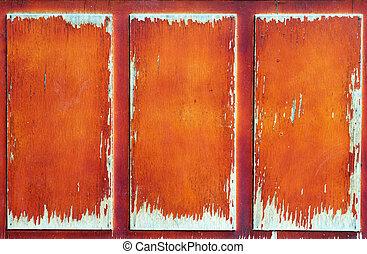 part of old wooden door in poor condition with peeling paint