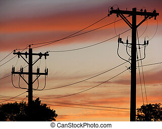 Power Line Sillhouette - Power lines silhouetted against a...