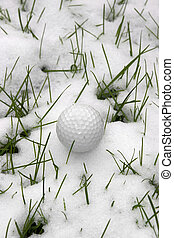 single dimpled golf ball in the snow - a lone single golf...