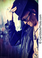 cryptic - Gothic man in black coat and top-hat over grunge...