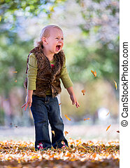 fall leaves - happy little girl throwing fall leaves