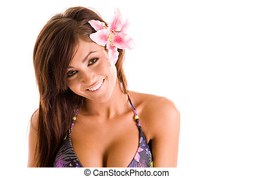 young woman in swimwear with a flower in her hair
