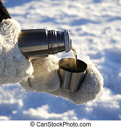 pouring warm drink outdoors