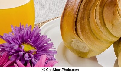 Croissants with orange juice - Closeup of croissants with...