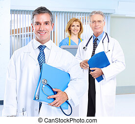 Smiling family doctor with stethoscope. Health care.