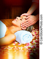 Face massage. - Beautiful woman having anti wrinkle face...