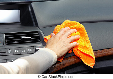 Hand cleaning car. - Hand with microfiber cloth cleaning...