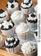 Iced Gourmet Cup Cakes - Close up of some decadent gourmet...