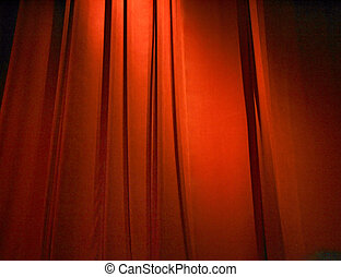 red closed curtain - a closed dark red curtain on stage