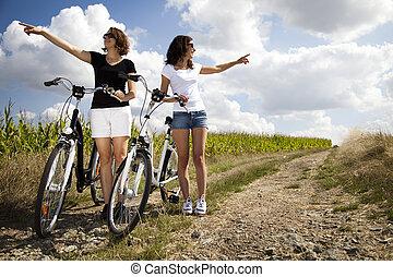 Young women riding bike