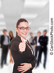 Business team at the office - Businesswoman thumb up in...
